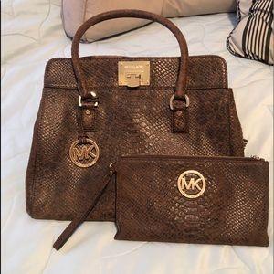 Michael Kors handbag.  Includes matching wristlet!